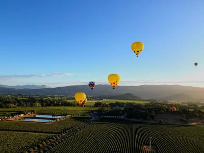 Three Yellow Balloons in a Row by Sean Flaherty