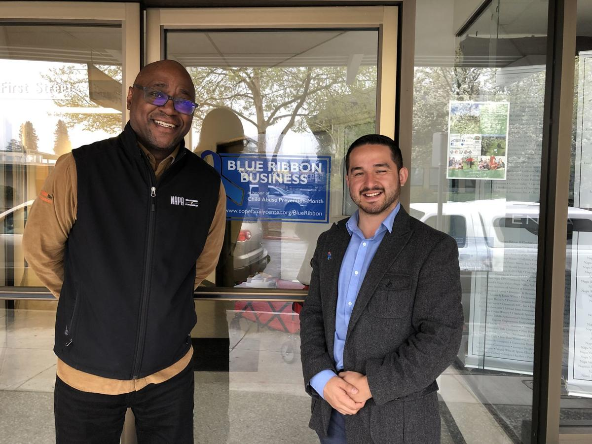 Travis Stanley of the Napa Chamber of Commerce and Ricky Hurtado of Cope Family Center, support Blue Ribbon Month