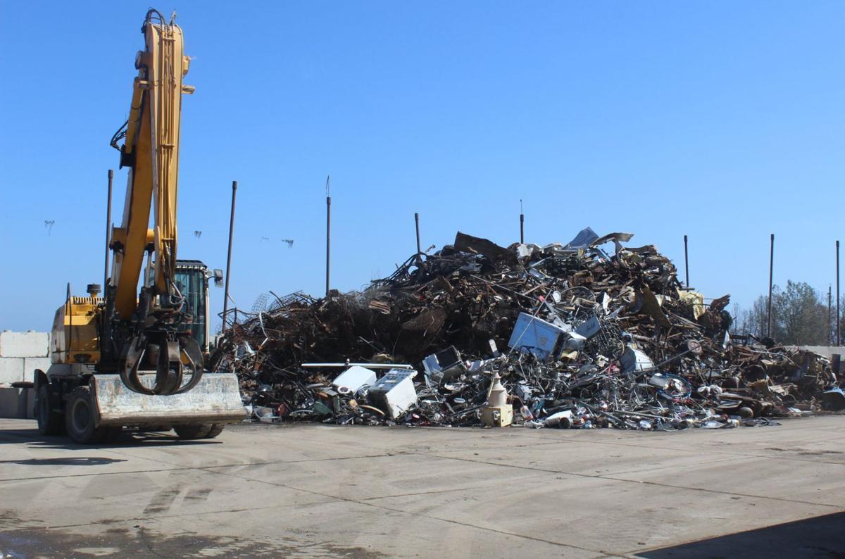 Crane sorts garbage at Clover Flat