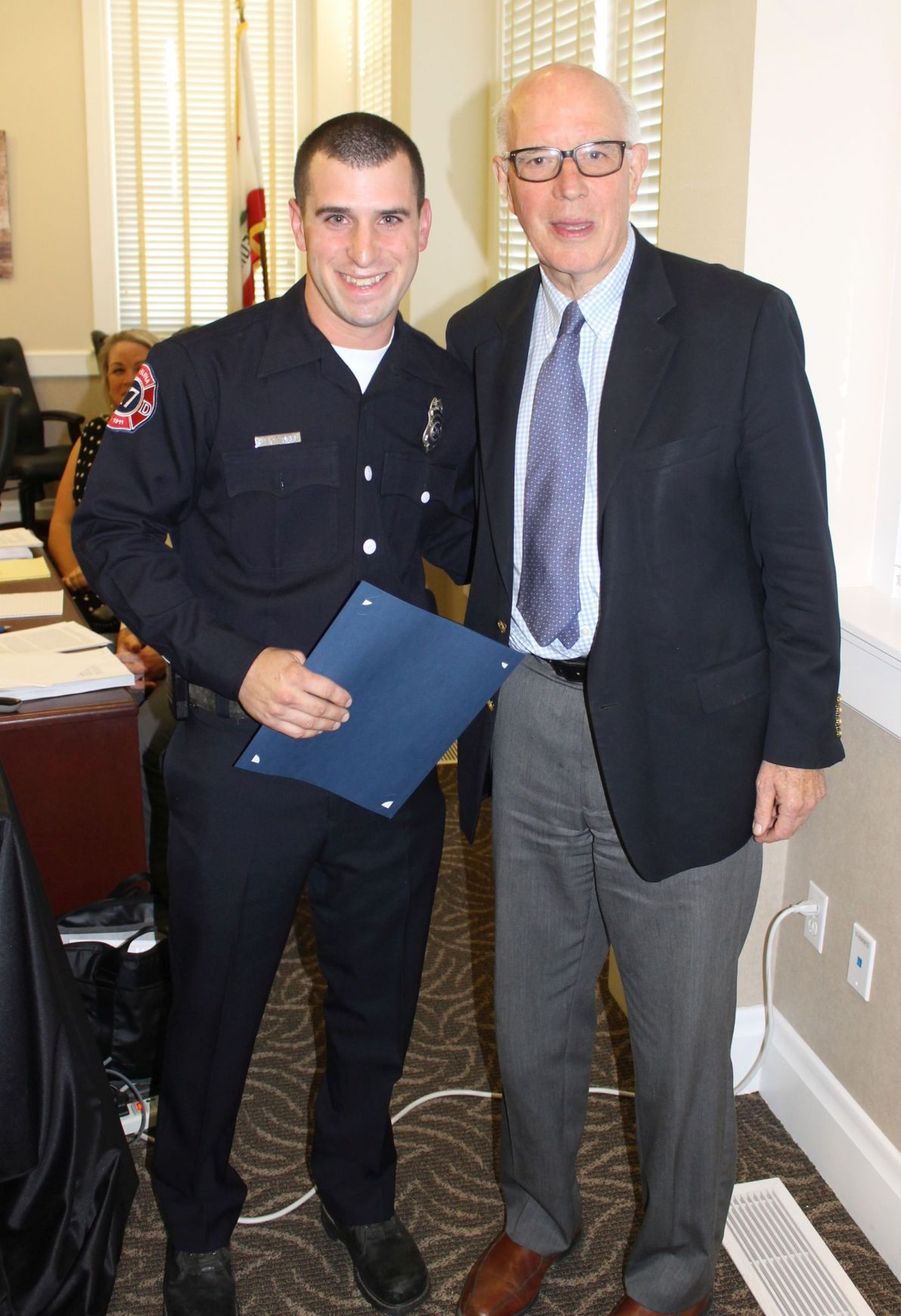 Mayor honors firefighter who pulled woman from burning car