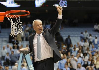 Head coach Roy Williams of the North Carolina Tar Heels celebrates as he cuts down the net after defeating the Duke Blue Devils 90-83 to clinch the ACC regular season title at the Dean Smith Center on March 4, 2017 in Chapel Hill, North Carolina.