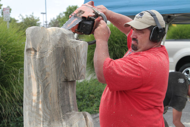 Bear of a task chain saw sculptor shows skills in napa