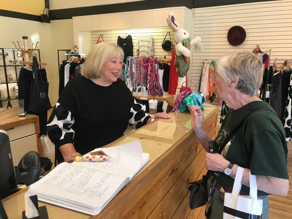 Barbara Wiggins, owner of the Mustard Seed, talks with customer Jan Wheadon