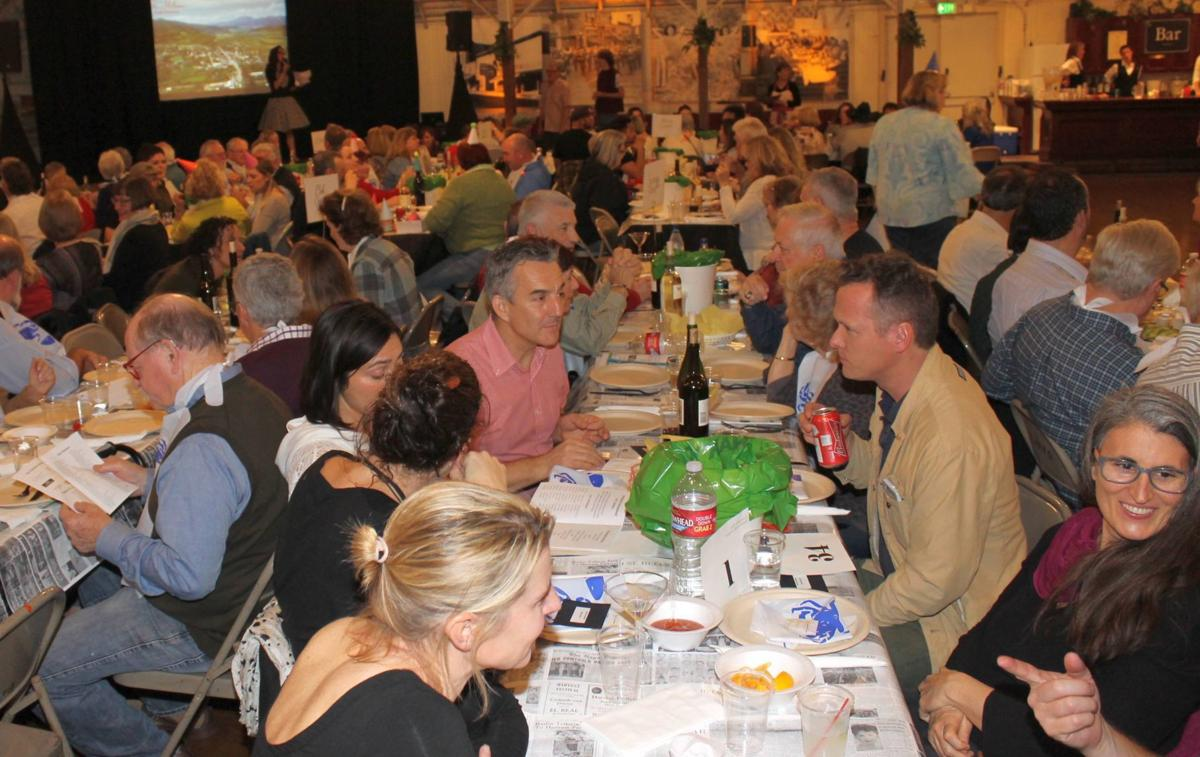 Socializing at the tables of the Soroptimists Crab Feed