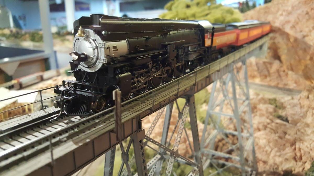 Train running on one of the bridges in the layout at the Napa Valley Model Railroad Historical Society