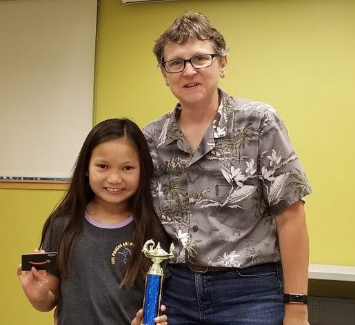 Fifth grade essay winner Madison Jew with Friends of the American Canyon Library President Shanda Neumeier.