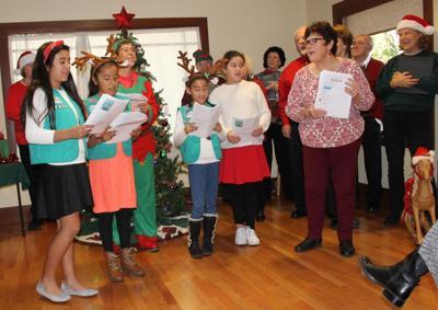 Girl Scouts singing at Rianda House