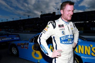 Dale Earnhardt Jr., driver of the #8 Hellmann's Chevrolet, stands next to his car after the NASCAR Xfinity Series Sport Clips Haircuts VFW 200 at Darlington Raceway on August 31, 2019 in Darlington, South Carolina.