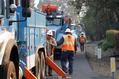 PG&E repairs power line damage after wildfires (copy)