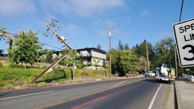 Power pole broken in crash