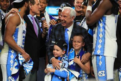 Head coach Roy Williams of the North Carolina Tar Heels celebrates with his team and grandchildren after defeating the Gonzaga Bulldogs during the 2017 NCAA Men's Final Four National Championship game at University of Phoenix Stadium on April 3, 2017 in Glendale, Arizona.