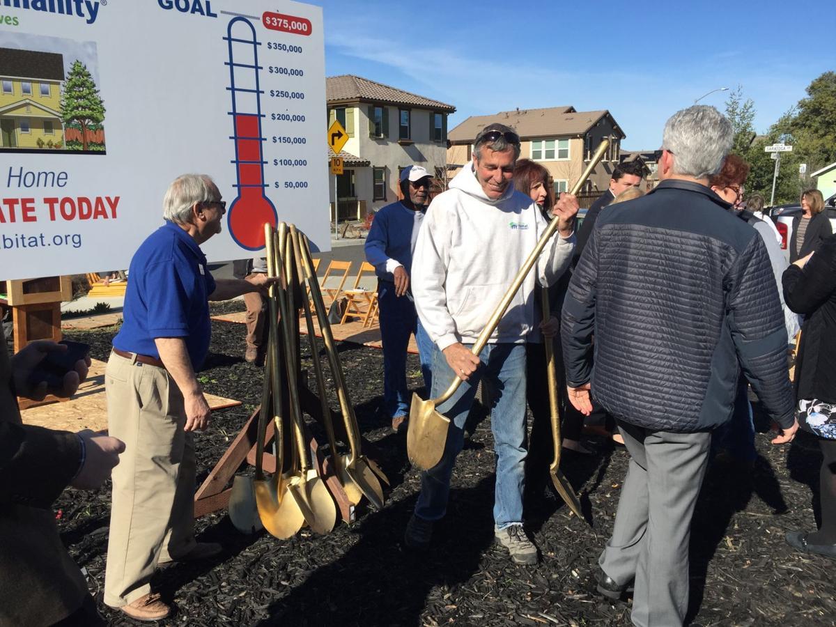 Habitat groundbreaking two guys with shovels