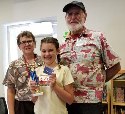 Emily Mortimore with Friends of the American Canyon Library President Shanda Neumeier and Treasurer Chuck Pearson.