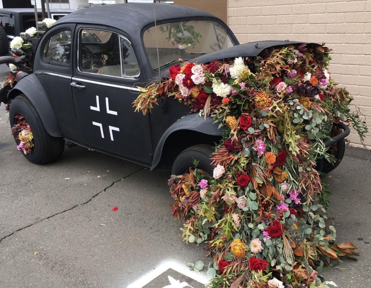 Wedding flowers recycled for VW Bug