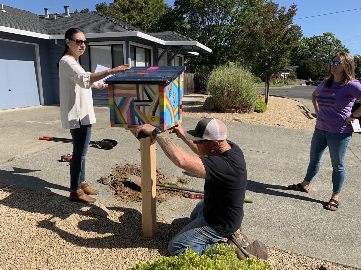 Installing a new Rainbow Little Library at Seasons of Wonder preschool in Napa