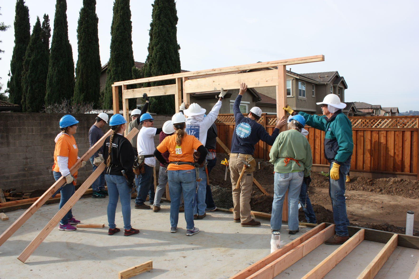 Volunteers Raise A Wall For The New Habitat For Humanity House In Napa.