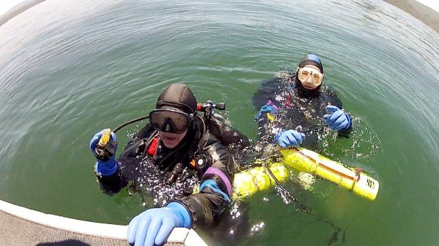 Divers Plunge Into Darkness To Recover History