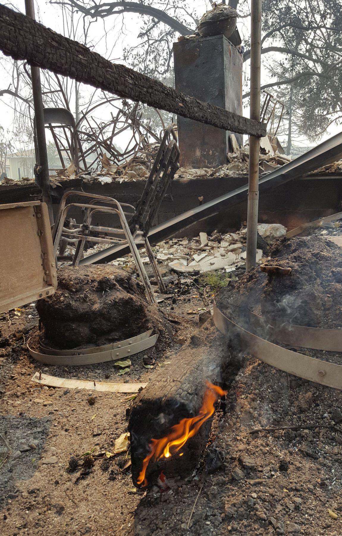 Burning plank on Hardman Avenue Atlas Peak Fire