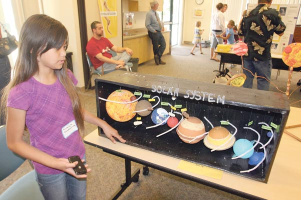 exploring new worlds local news com fifth graders display their knowledge at science fair