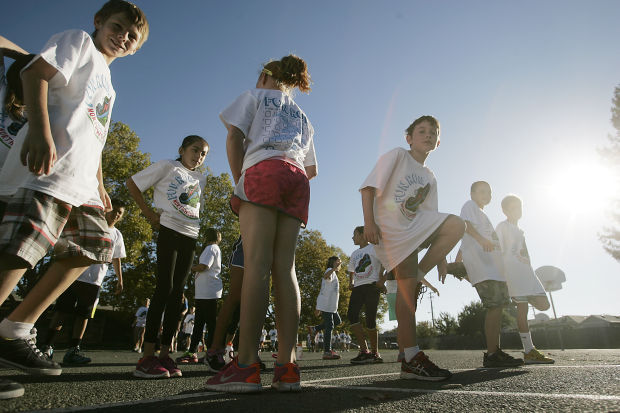 Kids Run In Circles At School Fundraiser
