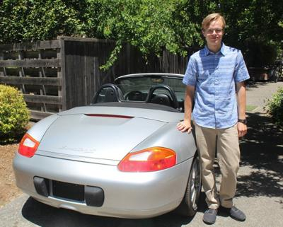 Isaac Kelly with electric Boxster