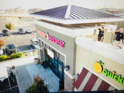 Law enforcement officers in American Canyon climbed to the top of the AmCan Dunkin' rooftop to bring attention to Special Olympics.