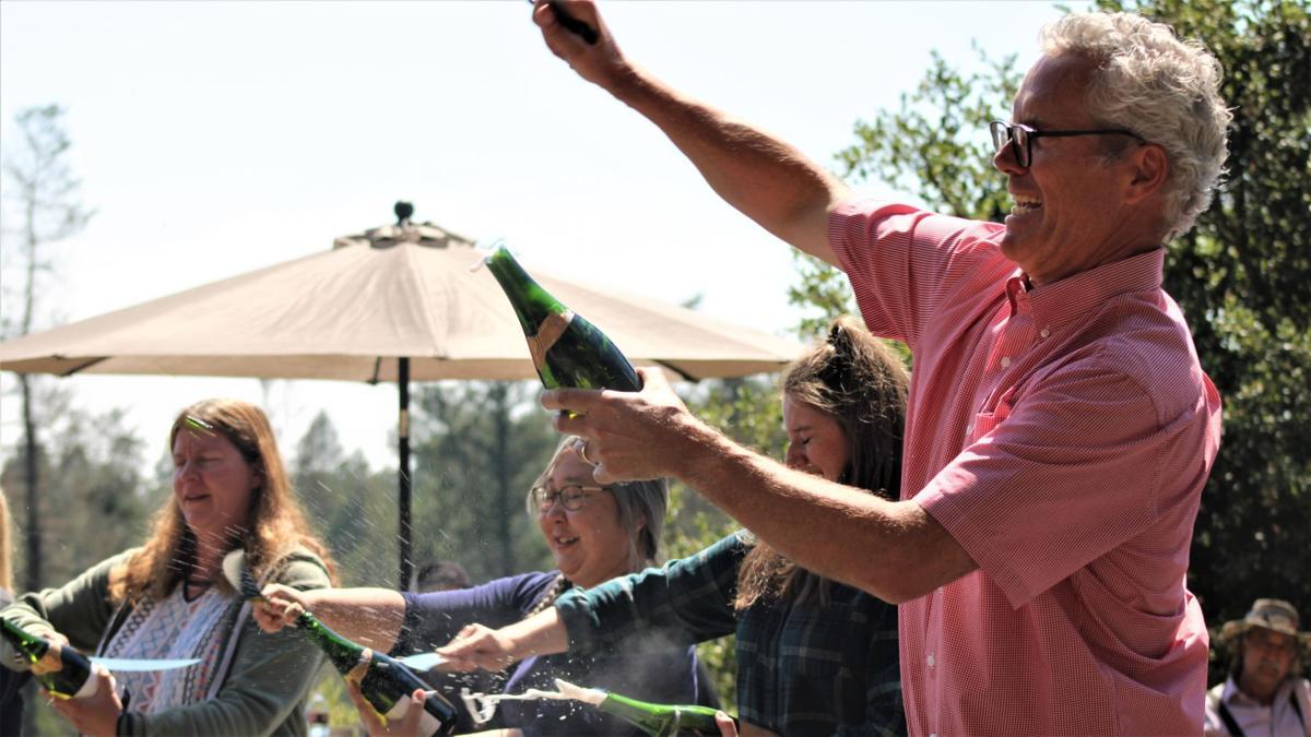 Hugh Davies sabers bottle