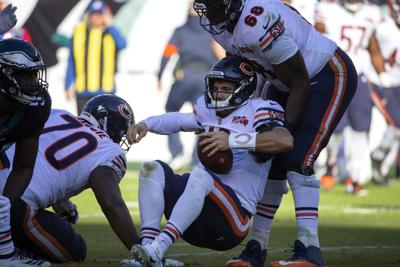 Chicago Bears quarterback Mitch Trubisky (10) is helped up by Chicago Bears offensive guard James Daniels (68) after being sacked during the second quarter by the Philadelphia Eagles on Sunday, Nov. 3, 2019, at Lincoln Financial Field in Philadelphia, Pa.
