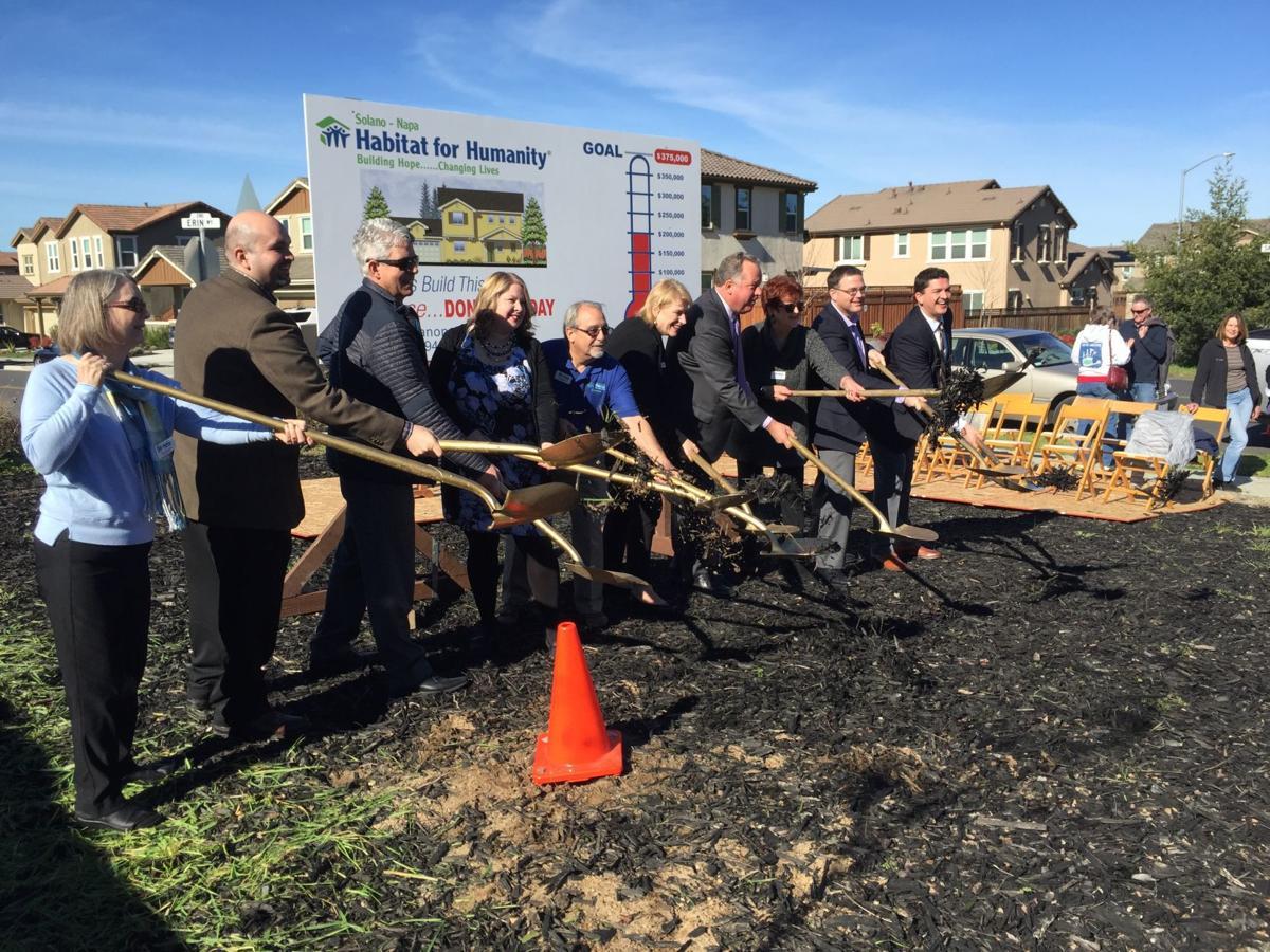 Habitat groundbreaking larger group posed with shovels