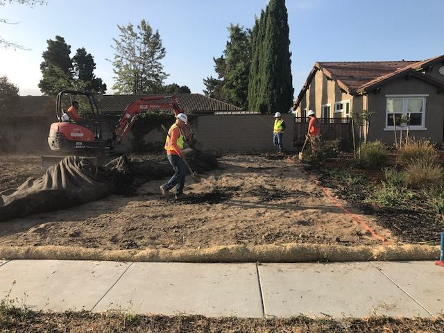 Workers Clear The Site For The New Habitat For Humanity Home In Napa.
