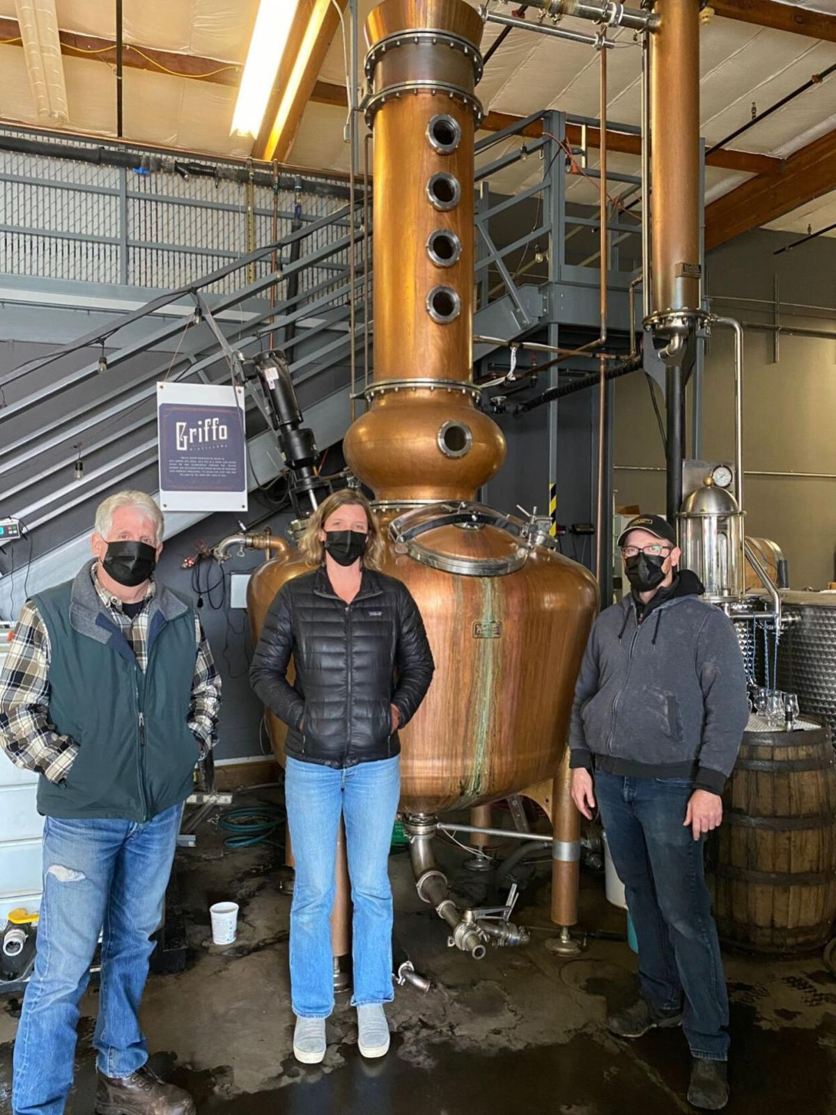 Tom Eddy, Jenny Griffo, Jason Gerard at distillery