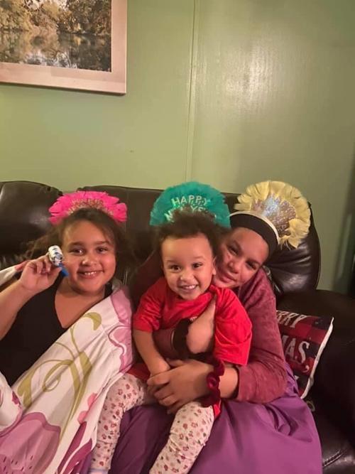 Megan Levin's children smile in a family photo.