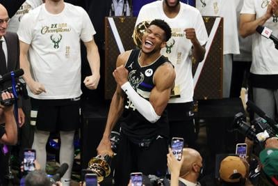 Giannis Antetokounmpo of the Milwaukee Bucks celebrates winning the Bill Russell NBA Finals MVP Award after defeating the Phoenix Suns in Game 6 to clinch the NBA championship at Fiserv Forum on Tuesday, July 20, 2021, in Milwaukee.