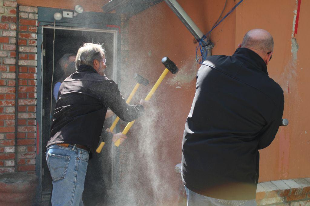Larry Turley swings a sledgehammer