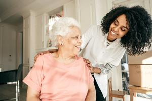 Young woman and elderly woman laughing 2