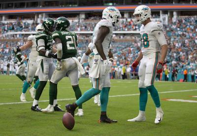 Miami Dolphins wide receiver DeVante Parker celebrates a touchdown with tight end Mike Gesicki.