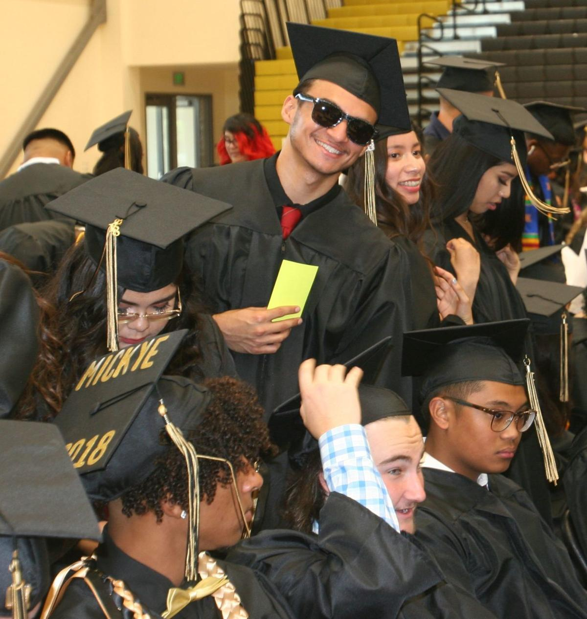 ACHS 2018 graduation smiles in the gym