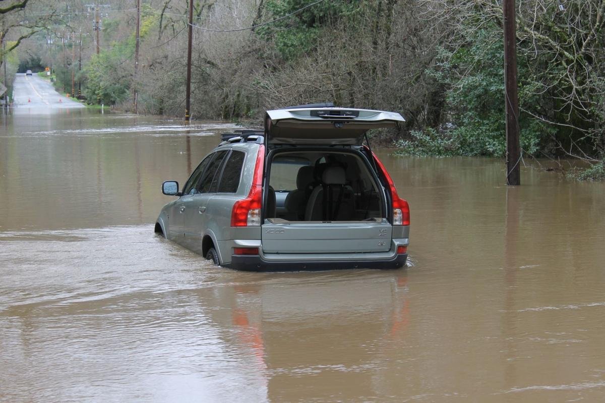 Motorist ignored barricade, trapped by flood water