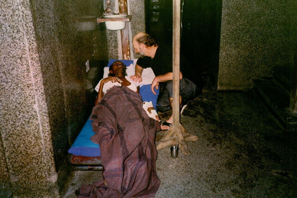 Bert Wooning comforts patient