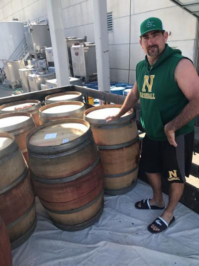 Dan Parker with wine barrels