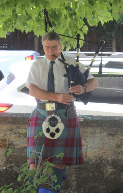 Lindsay Hall plays bagpipes