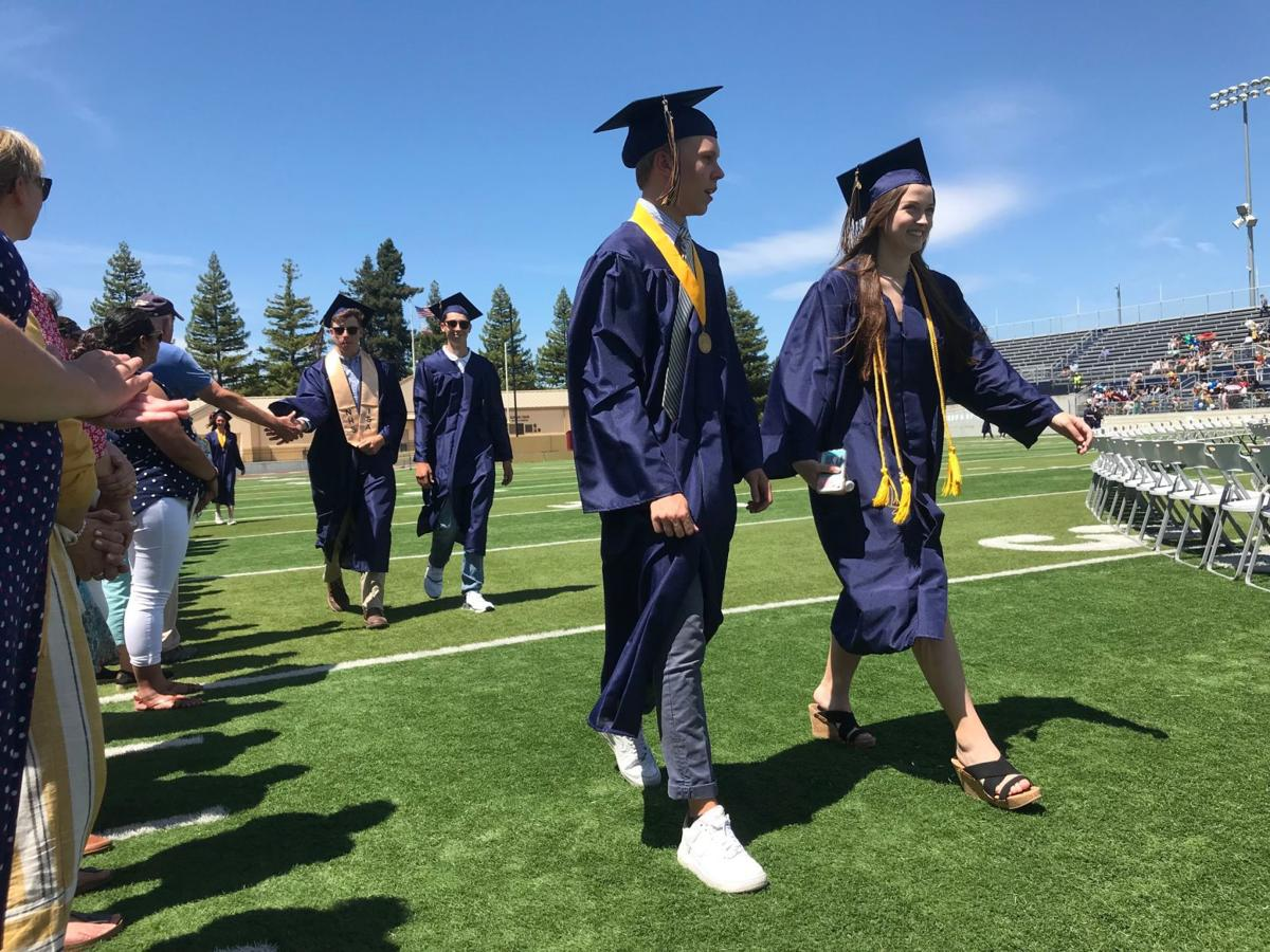 Members of Napa High School class of 2019 process into Memorial Stadium for graduation on Thursday.