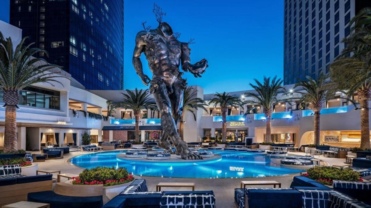 """The 60-foot """"Demon With Bowl"""" sculpture by Damien Hirst in the pool area of Palms Casino Resort in Las Vegas. The Kaos club closed in November."""