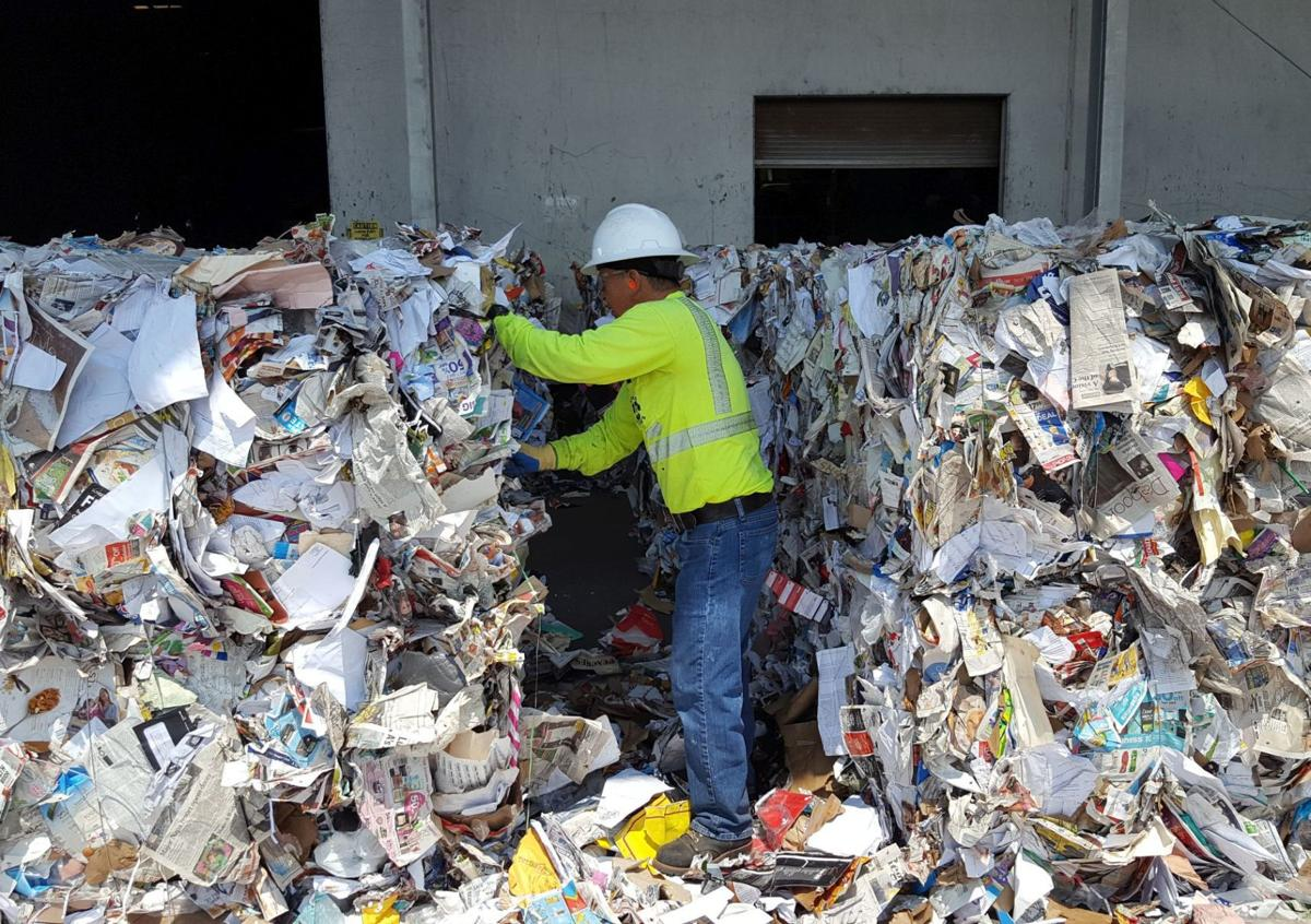 Worker at Napa Recycling & Waste Services pulling plastics