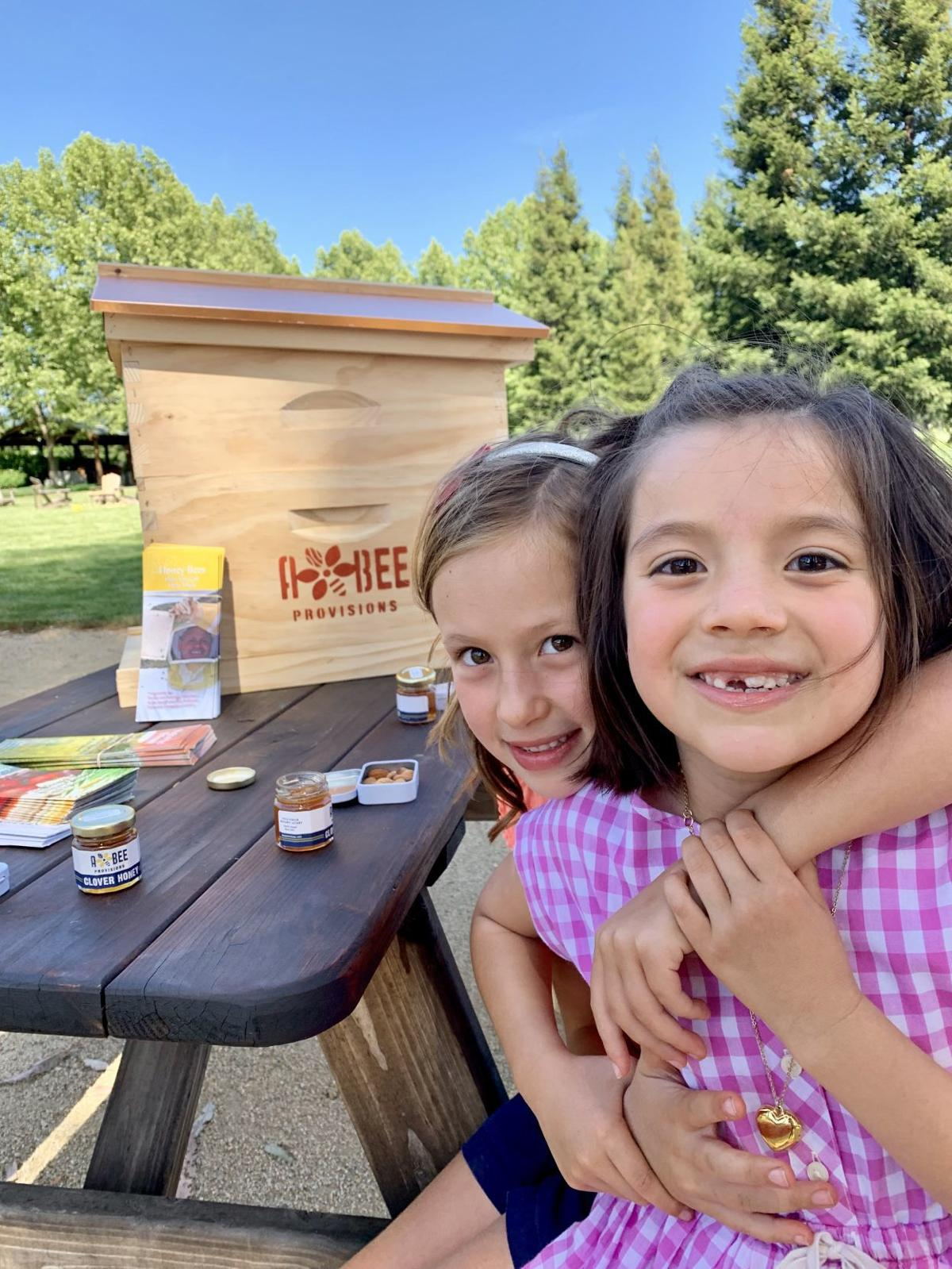 "These two guests enjoyed products from A & Bee Provisions at its recent ""Beekeeping Day"" at at Pestoni Family Estate Winery in St. Helena"
