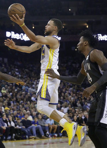Stephen Curry scores 34 points, leads Warriors past Nets