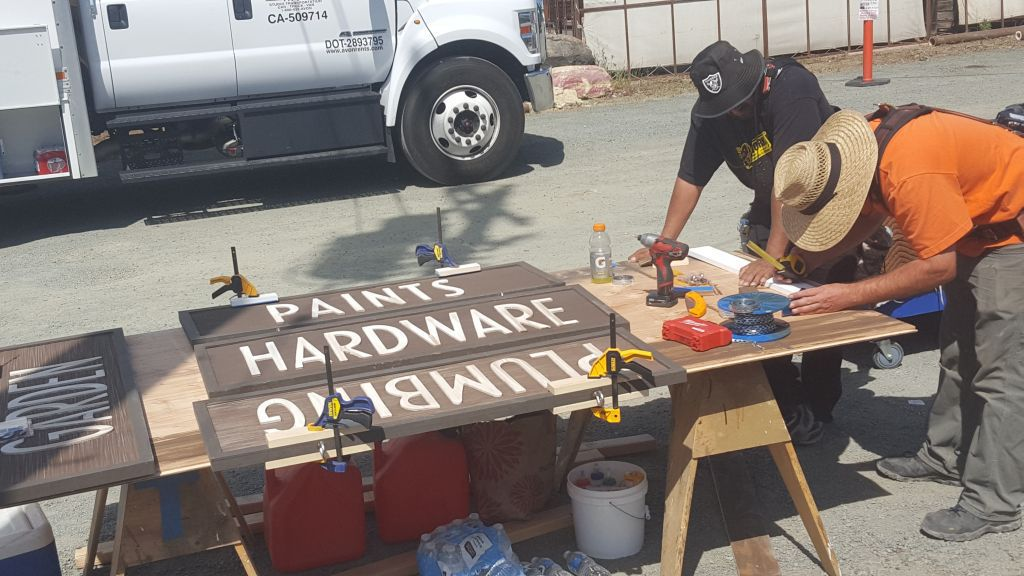 Carpenters work on new signs