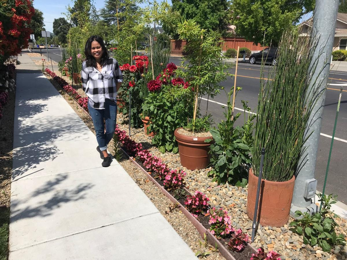 Marcell Gallagher with some of her plants on Trower Avenue.