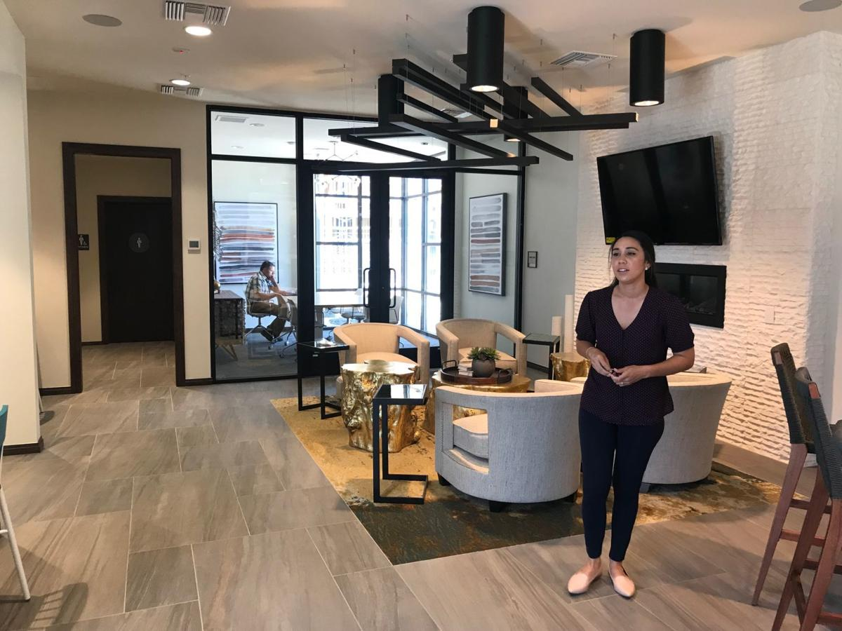 Lexi Heilig, assistant manager at The Braydon, shows part of a coworking space at the new apartment complex on Soscol Avenue.