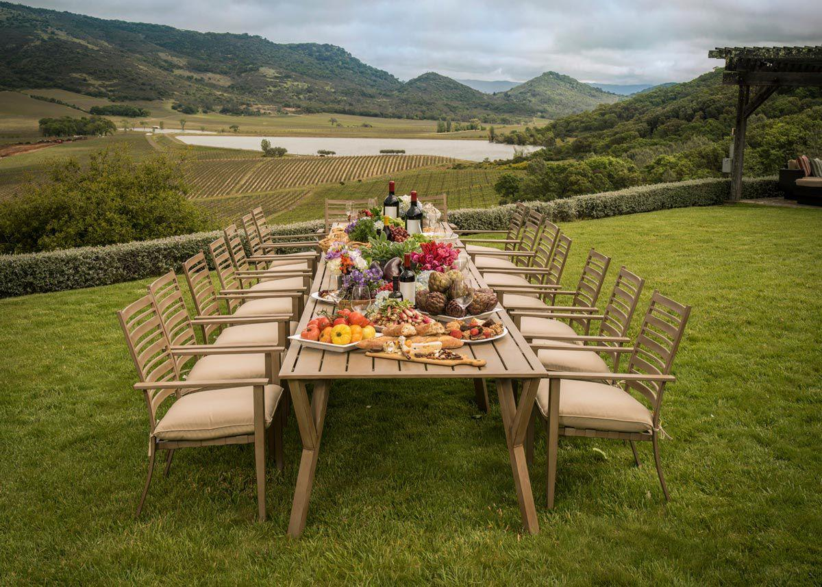table and chairs set up near vineyard